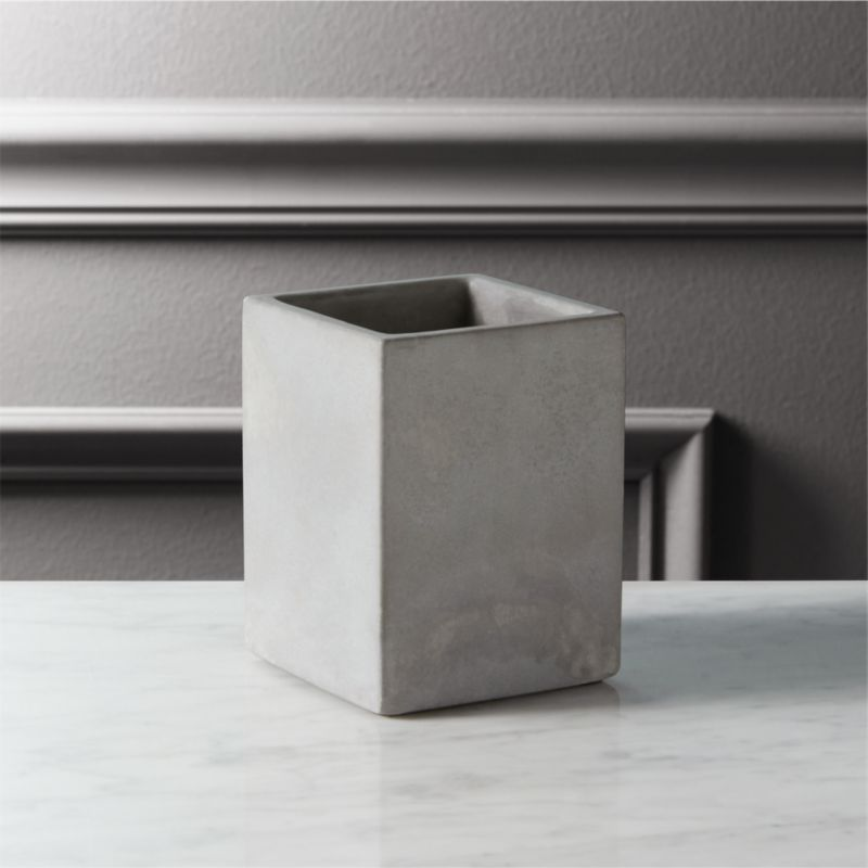 """<span class=""""copyHeader"""">concrete idea.</span> Rectangular vessel cements an industrial spot for pens and pencils. Honed smooth in matte grey with natural intonations, concrete works a minimalist architectural touch in the office. Perfect office mates with cement letter tray and catchall.<br /><br /><NEWTAG/><ul><li>100% concrete</li><li>Each will be unique</li><li>Wipe with clean cloth</li></ul>"""