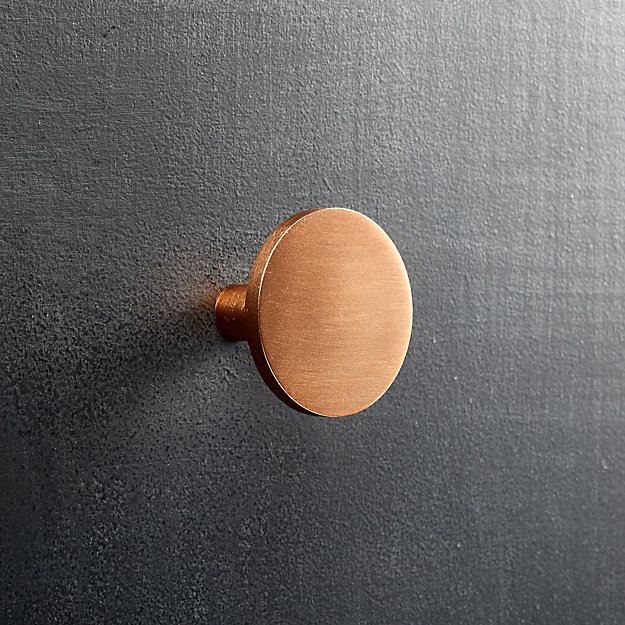 This transitional knob showcasing a beautiful dark antique This transitional knob showcasing a beautiful dark antique copper finish is part of our Deco family. Changing a knob is a quick way to update your space. Coordinating pulls are available.