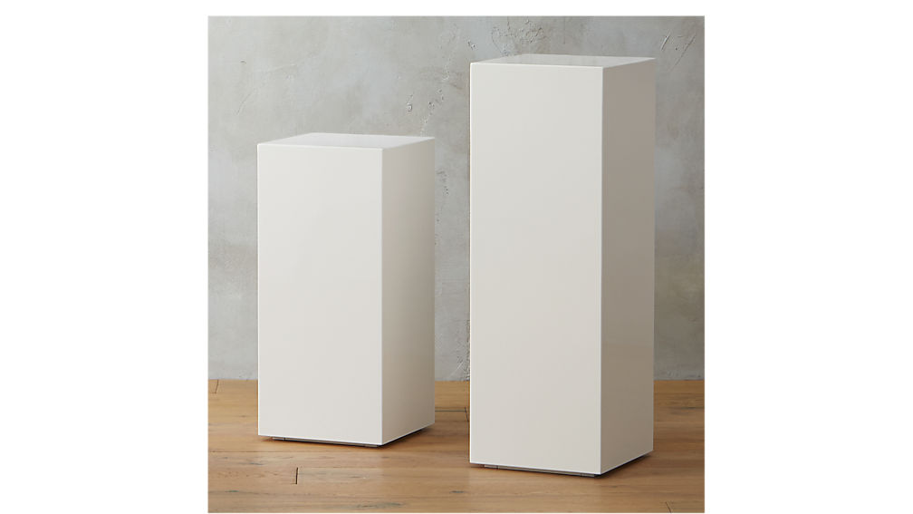 City Slicker White Pedestal Tables Cb2