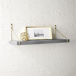 clad shelf with gold brackets