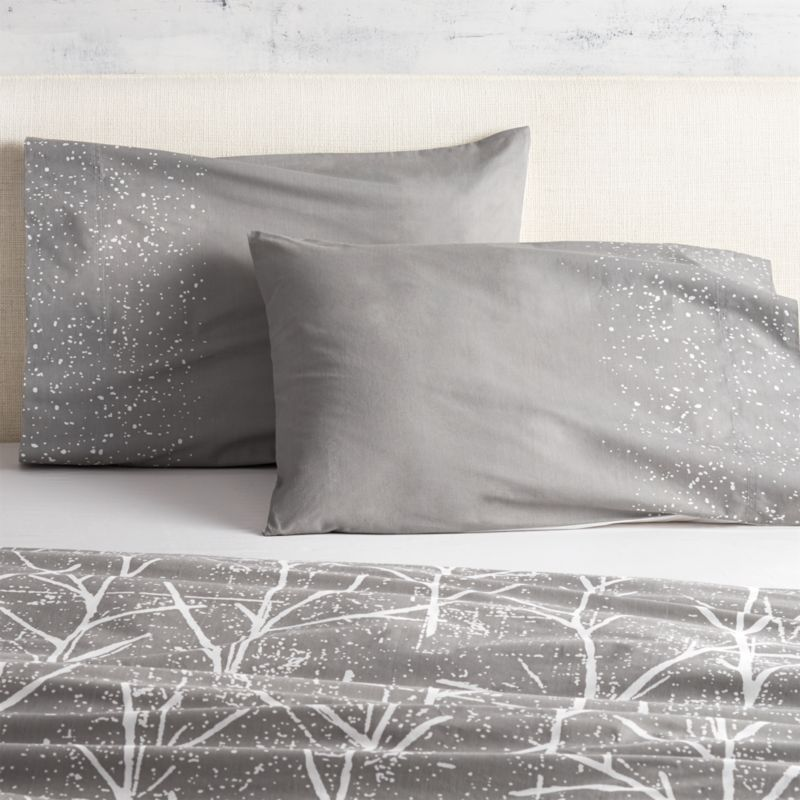 """<span class=""""copyHeader"""">branch out.</span> Painterly dots of white cascade over a field of grey as part of the modern forest imagined by Chicago-based designer Noël Ashby. Soft 200-thread-count cotton shams are finished neat with envelope closures; reverse to white. Dreamy with coordinating crumpled trees duvet cover.<br /><br /><NEWTAG/><ul><li>Designed exclusively for CB2 by Noël Ashby</li><li>100% cotton</li><li>200 thread count</li><li>Shams have envelope closure; reverse to white</li><li>Machine wash; do not dry clean</li></ul>"""