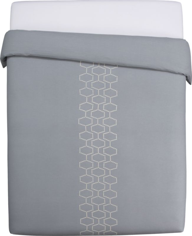 "<span class=""copyHeader"">hit the hive.</span> Little puffs of natural-toned embroidery chain together to create 3D honeycombs — or d'abeille in French — in three graphic rows on grey 250-count cotton. Duvet cover has non-slip corner ties and hidden button closure.<br /><br /><NEWTAG/><ul><li>100% cotton</li><li>250 thread count</li><li>Duvet has non-slip corner ties and hidden button closure; reverses to matching pattern</li><li>Machine wash</li></ul>"