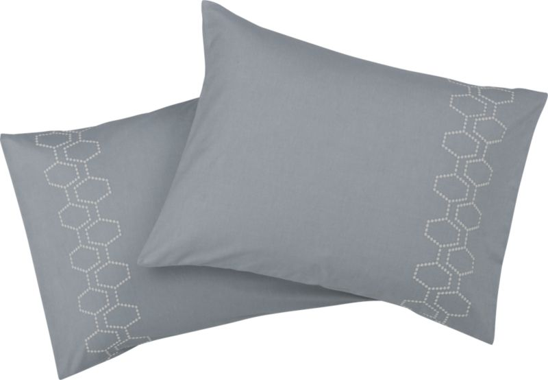 """<span class=""""copyHeader"""">hit the hive.</span> Little puffs of natural-toned embroidery chain together to create 3D honeycombs — or d'abeille in French — in two graphic rows on grey 250-count cotton. Grey shams link up with matching pattern on outer edge, both sides. Finished neat with envelope closure.<br /><br /><NEWTAG/><ul><li>100% cotton</li><li>250 thread count</li><li>Shams have envelope closure; reverses to matching pattern</li><li>Machine wash</li></ul>"""