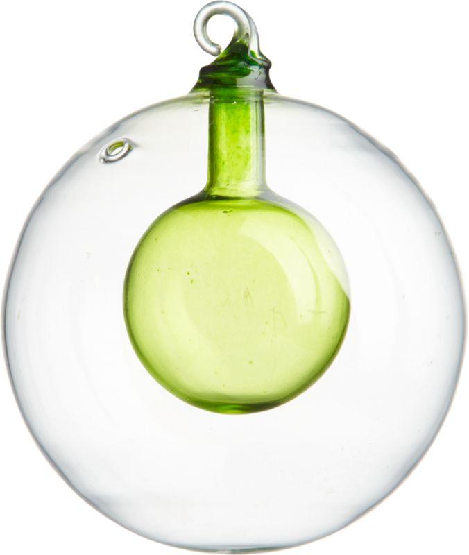 "<span class=""copyHeader"">inner glow.</span> Modern merry, inside-out. Clear beaker glass orb floats a translucent green bulb.<br /><br /><NEWTAG/><ul><li>Painted borosilicate (""beaker"") glass</li></ul>"