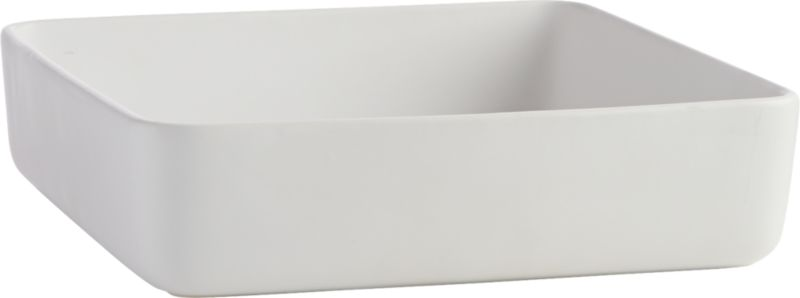 """<span class=""""copyHeader"""">squared away.</span> Handmade stoneware baking dish bakes and serves oven-to-table in matte white. Smooth contours round the corners, and generous proportion dishes everything from lasagna to fruit crisps and crumbles. Dines well with matte evergreen server/baker.<br /><br /><NEWTAG/><ul><li>Handmade</li><li>Stoneware in matte white</li><li>Microwave- and dishwasher-safe</li><li>Oven-safe to 350 degrees (no more than 2 hours)</li></ul>"""