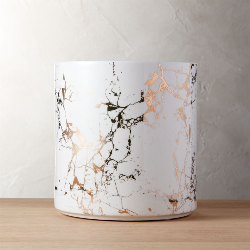 """<span class=""""copyHeader"""">so vein.</span> Thin ceramic cylinders mimic marble with a metallic twist. Gold metallic decal on bright white plants indoor greens in style. Pair hi/lo with the Palazzo marbleized planter small.<br /><br /><NEWTAG/><ul><li>Ceramic with gold decal</li><li>No drainage holes</li><li>Clean with a soft cloth</li></ul>"""