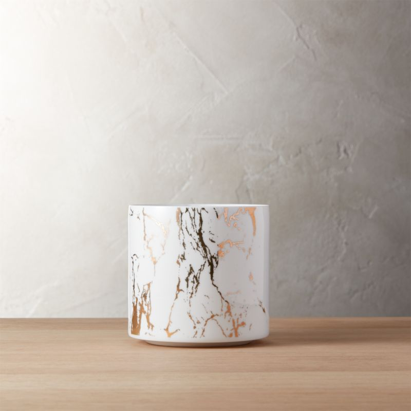 """<span class=""""copyHeader"""">so vein.</span> Thin ceramic cylinders mimic marble with a metallic twist. Gold metallic decal on bright white plants indoor greens in style. Pair hi/lo with the Palazzo marbleized planter large.<br /><br /><NEWTAG/><ul><li>Ceramic with gold decal</li><li>No drainage holes</li><li>Clean with a soft cloth</li></ul>"""
