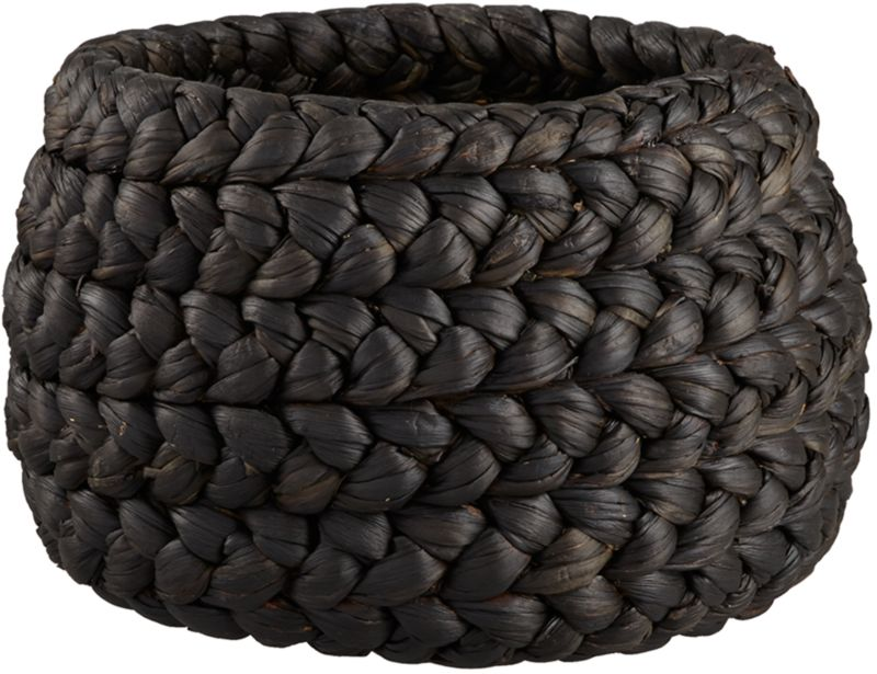 """<span class=""""copyHeader"""">fashion plait.</span> Weaving a modern tale of form and texture, natural water hyacinth is dyed black, hand-braided and coiled into a chunky, rounded form. Declutters with character. Double the fun with rapunzel low white basket.<br /><br /><NEWTAG/><ul><li>Handmade</li><li>Water hyacinth dyed black with matte lacquer finish</li><li>Due to handmade process, each is unique</li><li>Gently wipe clean with a soft, dry white cloth</li></ul>"""