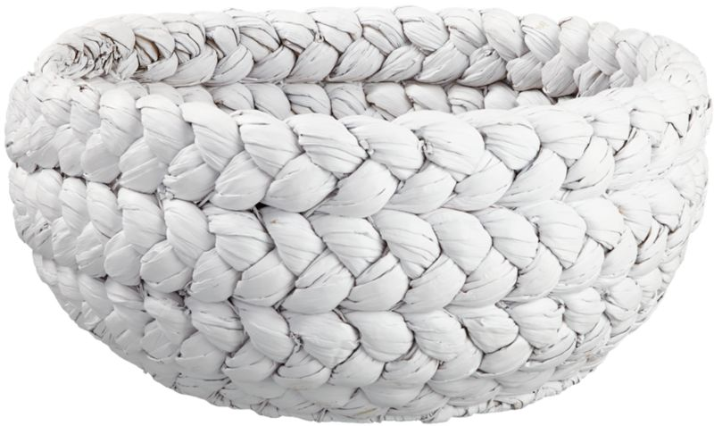 """<span class=""""copyHeader"""">fashion plait.</span> Weaving a modern tale of form and texture, natural water hyacinth is dyed white, hand-braided and coiled into a chunky, rounded form. Declutters with character. Double the fun with rapunzel large black basket.<br /><br /><NEWTAG/><ul><li>Handmade</li><li>Water hyacinth dyed white with matte lacquer finish</li><li>Due to handmade process, each is unique</li><li>Gently wipe clean with a soft, dry white cloth</li></ul>"""