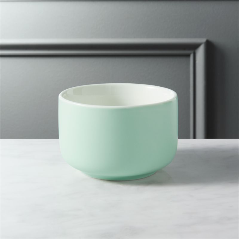 """<span class=""""copyHeader"""">candy coated.</span> Mini porcelain bowl glazed matte mint green is a sweet spot for candy, nuts, small bites. Fun as a trio with roundish mini bowls pink and salmon.<br /><br /><NEWTAG/><ul><li>Porcelain</li><li>Exterior: Matte mint green glaze; Interior: Glossy white glaze</li><li>Dishwasher- and microwave-safe</li></ul>"""