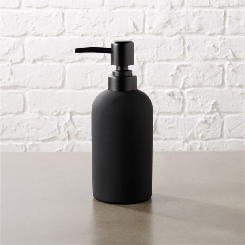 "<span class=""copyHeader"">dark side of clean.</span> Noir take on a sinkside staple dispenses modern drama. Black rubber is smooth to the touch on ceramic pump.<br /><br /><NEWTAG/><ul><li>Stoneware with black rubber coating</li><li>Wipe with damp cloth</li></ul>"
