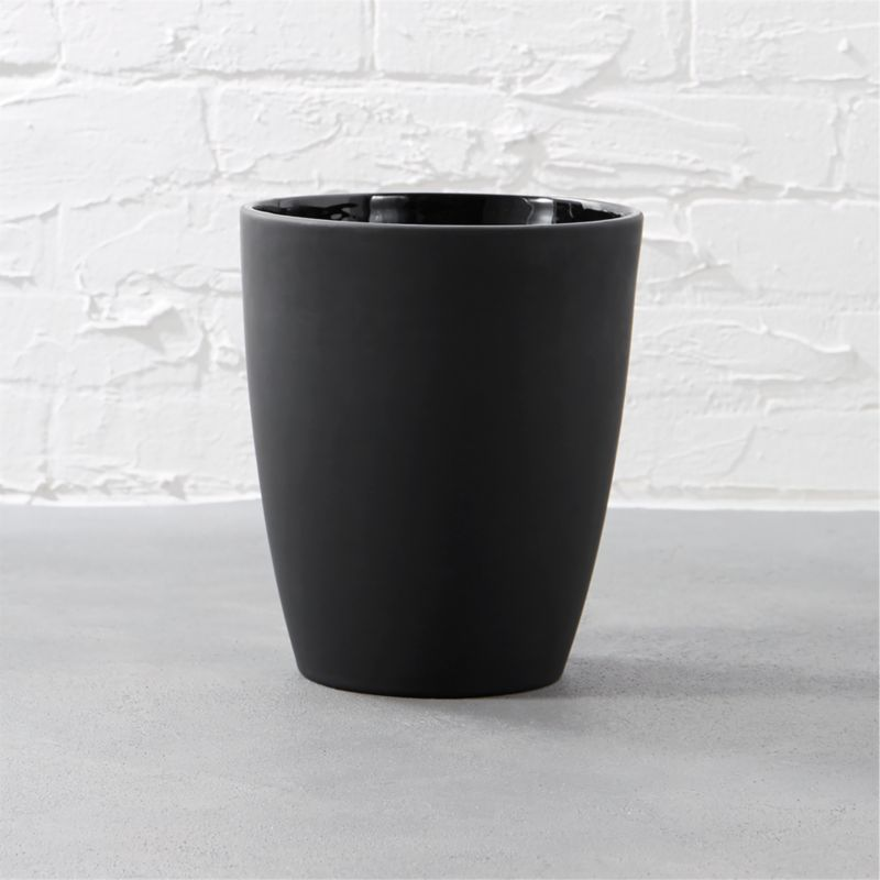 """<span class=""""copyHeader"""">noir side of neat.</span> Tactile stoneware catchall makes a pitch for modern drama. Black rubber is smooth to the touch outside with contrasting slick interior.<br /><br /><NEWTAG/><ul><li>Stoneware with black rubber coating</li><li>Wipe with damp cloth</li></ul>"""