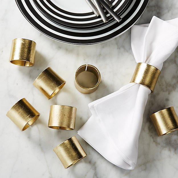 set of 8 scott gold napkin rings.