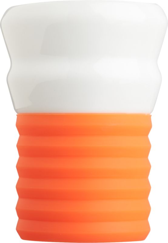 """<span class=""""copyHeader"""">espresso yourself.</span> Add a shot of color to your morning or nightly caffeine routine. Hand-dipped porcelain cup tucks into removable ribbed silicone bottom in buzz-inducing neon orange. Ridged grip feels good in the hand.<br /><br /><NEWTAG/><ul><li>Hand-dipped porcelain</li><li>Removable ribbed silicon base</li><li>Dishwasher-safe</li></ul><br />"""