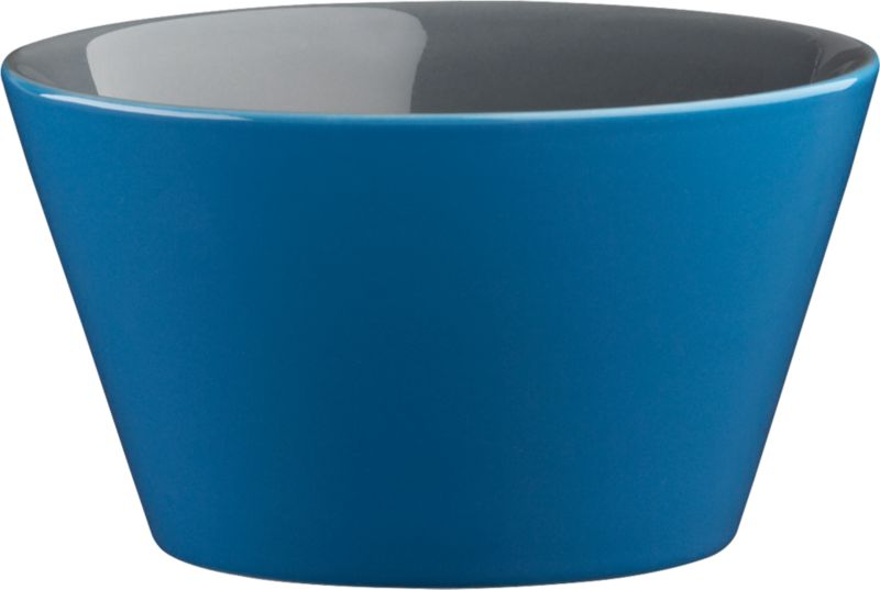 """<span class=""""copyHeader"""">bowled over.</span> Two-tone stoneware bowl is a colorful character, inside and out. Hi-gloss blue exterior plays bold off grey interior to pop everything from soup to nuts. Handmade dish with deep, angled sides stacks to store.<br /><br /><NEWTAG/><ul><li>Handmade</li><li>Glazed stoneware</li><li>Blue exterior; grey interior</li><li>Stackable</li><li>Dishwasher- and microwave-safe; oven-safe at 350-degrees up to two hours</li></ul>"""