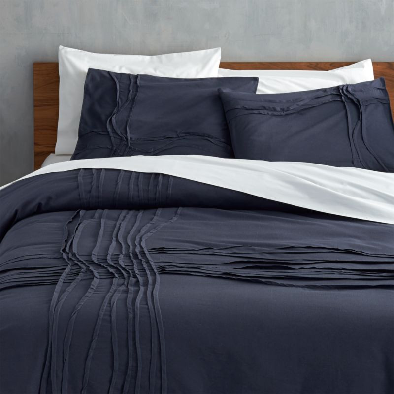 "<span class=""copyHeader"">monochromatic merge.</span> Navy-on-navy sleepscape dreams up tone-on-tone texture. Woven of soft cotton/linen, flowing ribbons of fabric cross paths off-center in an organic ripple effect. Duvet reverses to solid navy. Duvet has non-slip corner ties and hidden button closure.<br /><br /><NEWTAG/><ul><li>Cotton/linen</li><li>250 thread count</li><li>Duvet has non-slip corner ties and hidden button closure; reverses to solid navy</li><li>Machine wash; line dry</li></ul><br />"