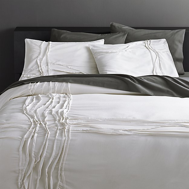 twisted white bed linens