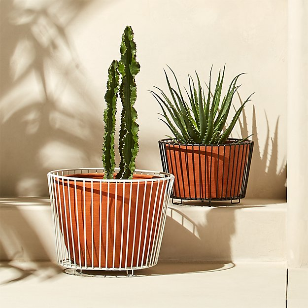 wire and terracotta planters