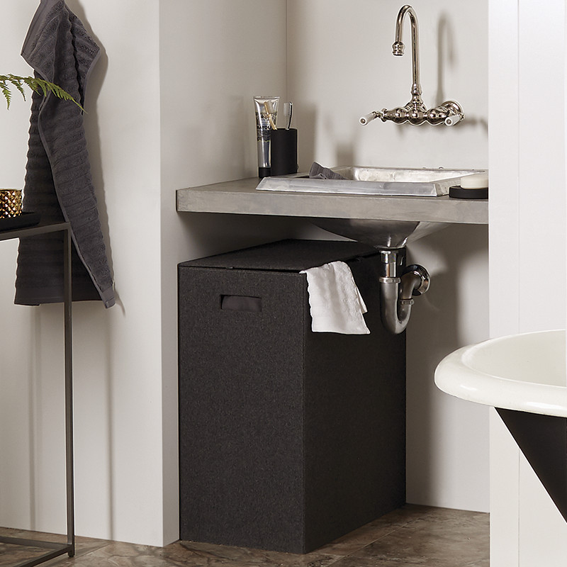 8. This hamper corrals loose clothes and towels. Our charcoal felt hamper makes dirty laundry look nice and neat. It's made of a charcoal menswear wool felt ...